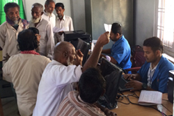 Operators seen assisting the public in looking for the records in the Legacy Data during the launch of NRC Updation process in the State