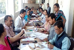 Officials checking documents related to land records etc at the Centralised OV cells that are being set up for Revenue departments at the premises of the DC Office Nagaon Dec, 2016.