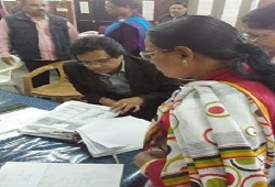 State Coordinator NRC checks the Office Verification documents at the Office Verification Cell in Nagaon today (7th Dec, 2015).