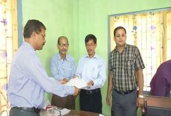 Shri Prabhat Narayan Kalita, first applicant for NRC Updation submitting his application at NSK, Chandrapur on 9th May, 2015