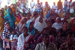 Public gathers for a public awareness meeting held on NRC Updation process