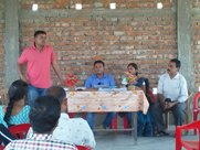 Government officials addressing the public during an awareness meeting in Golaghat District