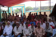 Public attends an awareness meeting organised at Neelam Bazar in Karimganj District