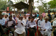 Public seen going through the NRC leaflets distributed during an awareness meeting held at Habi Baranga Bari in Morigaon District