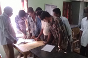 Public gathers at an NSK in Golaghat District and looks up for their record at the Legacy Data during the Statutory Publication of Legacy Data phase
