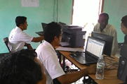 Operators at an NSK in Goalpara District assist the public in looking up for records in the Legacy Data