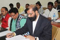 Dr. Samujjal Bhattacharya (extreme right), AASU Advisor along with an AASU Leader during a meeting held on NRC Updation process
