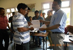 First Applicant of NRC Updation, Sonitpur distict, Shri Khogeswar Mudoi receives his Acknowledgment Receipt from Shri Jadav Saikia, ADC & Nodal officer, NRC, Sonitpur.