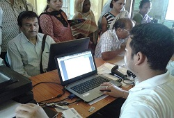 Veteran actor Nipon Goswami submitting his NRC Application Form in Guwahati recently.